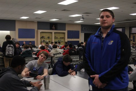Senior Jake Campbell spends time with teammates in lunchroom