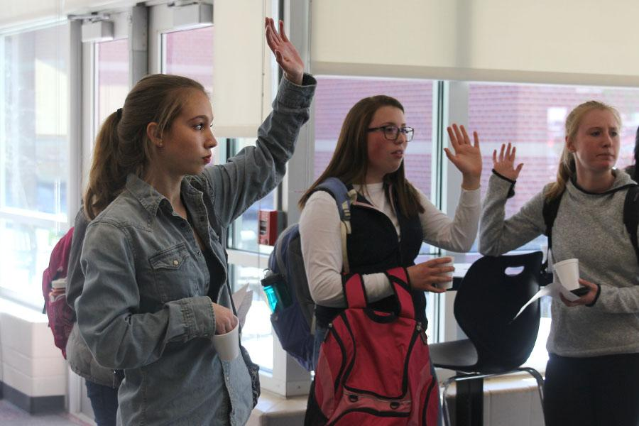 During+the+StuCo+student+forum+on+Tuesday%2C+March+7%2C+sophomore+Kate+Backes+raises+her+hand.+