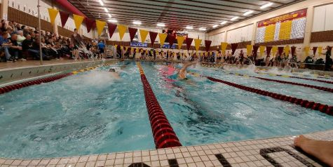 Boys swimmers win close meet