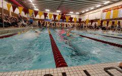 Boys swimmers win close meet