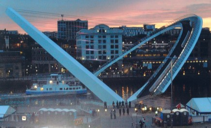 The Millenium Bridge, showing the Sage theatre in the background. The bridge consists of two curved arches one of which holds the foorbridge,and pivots where meets the bank, to allow the footbridge to be raised for shipping to pass under.