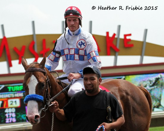 Eagles Span gets ready to enter the winners' circle after capturing the Mystic Lake Northlands Futurity
