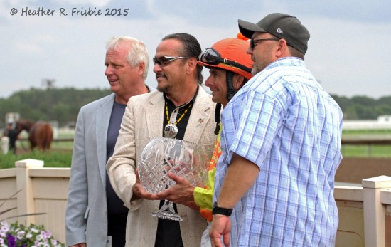From left, Canterbury President Randy Sampson, Shakopee Mdewakanton Sioux Community Vice-Chair Charlie Vig present the Mystic Lake Mile trophy to victorious jockey Corey Lanerie and trainer Gary Scherer.