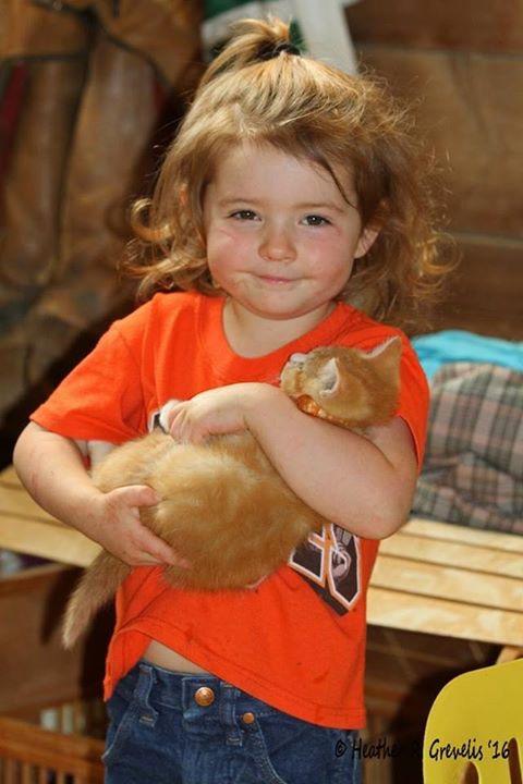 Cooper with her beloved cat, Orange Orange