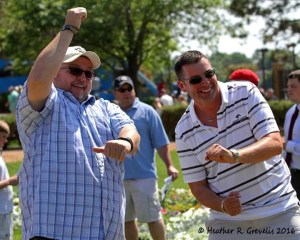 Trainers Gary Scherer (L) and Robertino Diodoro dancing in the paddock.