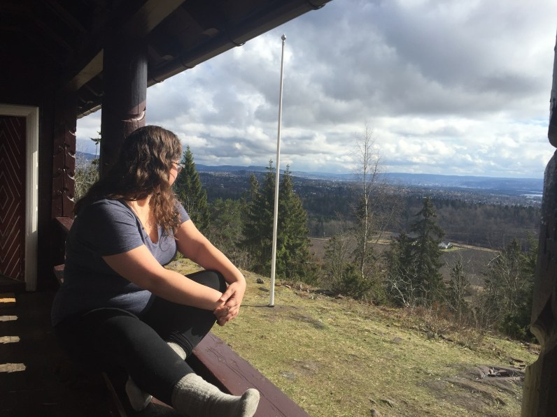 Megan enjoys the view over Olso and Olsofjord from the NExT cabin retreat.