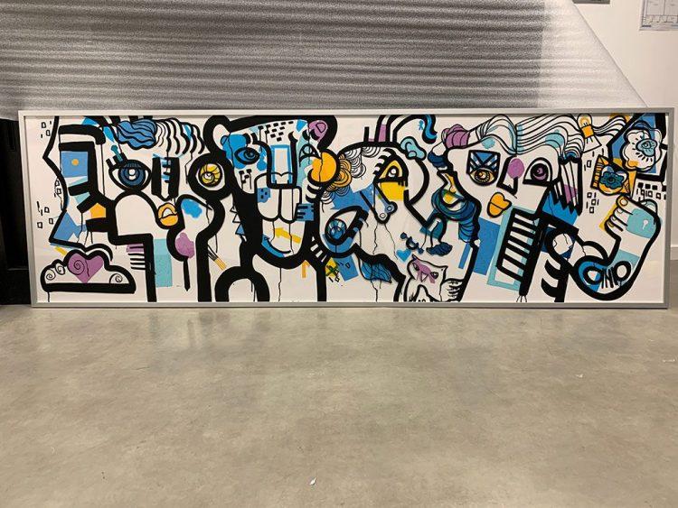un tableau oeuvre d'art collective exposé au salon préventica