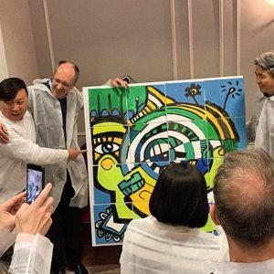 Fresque Puzzle Peinture : Les collaborateurs ont finis le puzzle peinture et sont fières de ce qu'ils ont accomplis