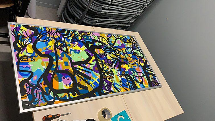 Fresque Plexi Art encadrée après un team building artistique à Lyon
