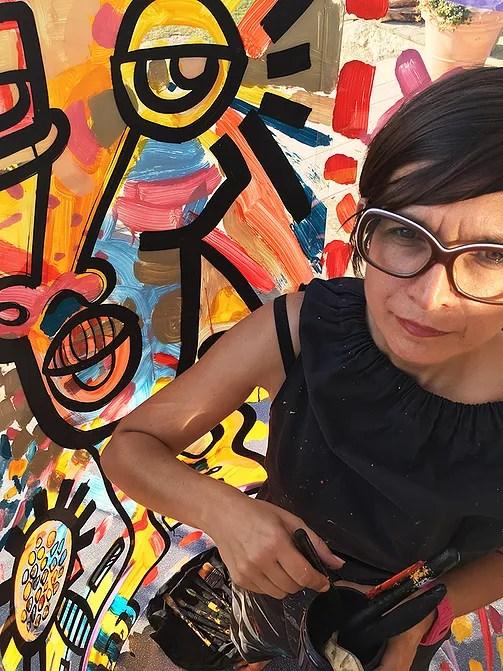 ana est une artiste qui spécialiste de la fresque événementielle et de team building à Lyon et dans toute la France
