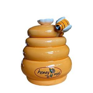 Honingpotje met honinglepel bijtje