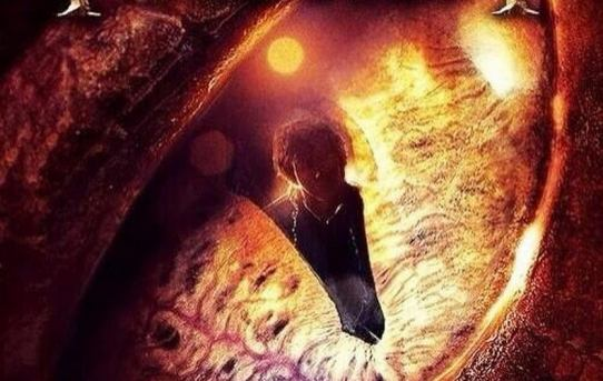 """Poster from """"The Hobbit: The Desolation of Smaug """" featuring Bilbo Baggins the burglar reflected in Smaug's eye."""