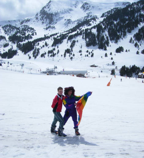 Skiers with gay flag on Andorran ski slope