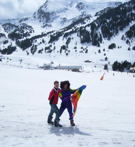 Skiers with gay flag on Andorran ski slope