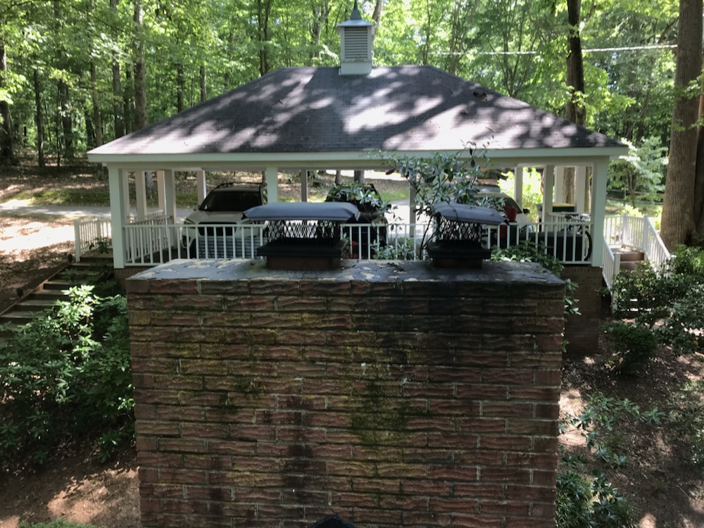 Old black worn out chimney caps