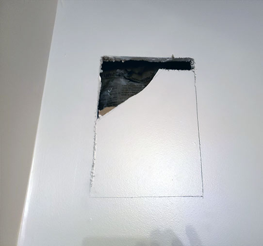 Cutting out sheetrock to mount rear surround speaker flush with the wall