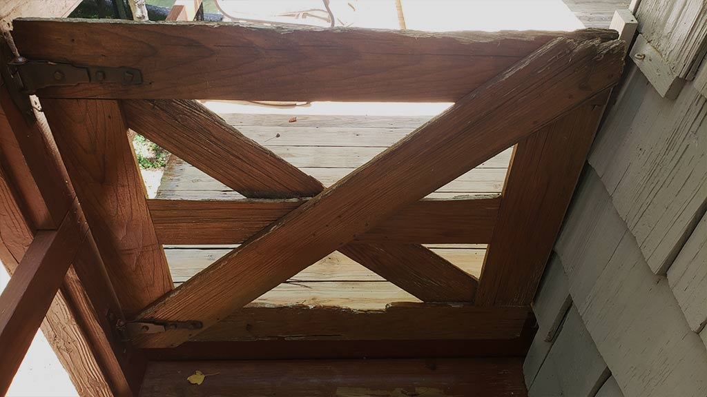 old Farm house style deck gate closed
