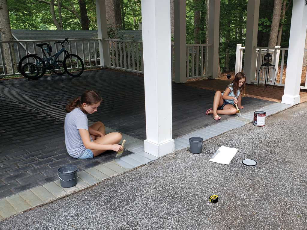 Two girls learn How to Clean and Paint a Cement Floor in One DAY