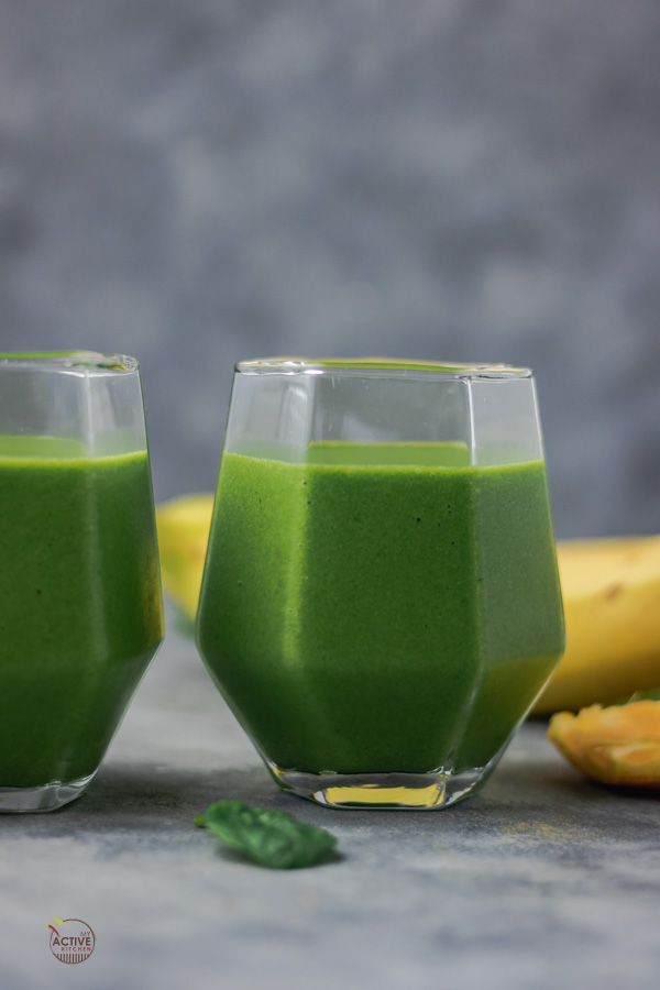 green smoothie in two glasses.