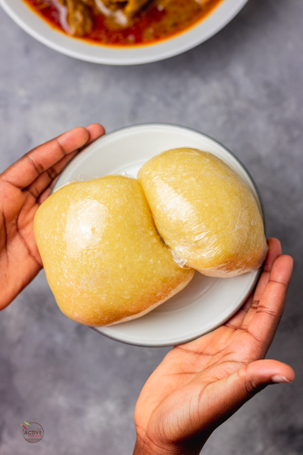 2 wraps of Nigerian eba food in a plate.