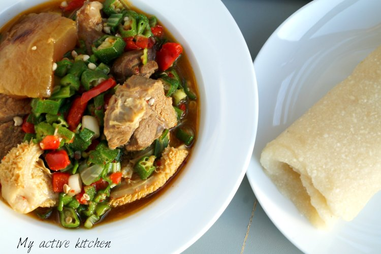 okra soup in a bowl with rolled eba