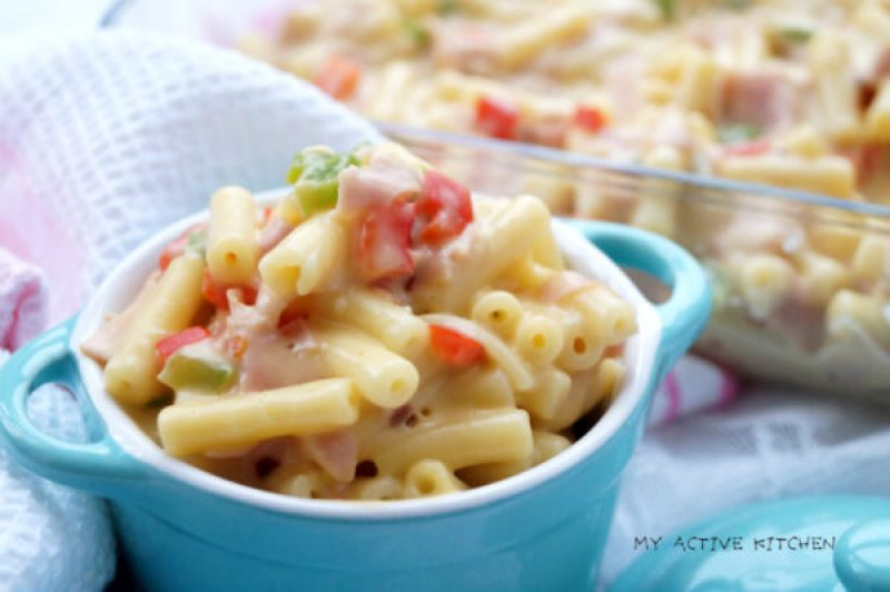 mac and cheese with peppers in a small blue ramekin