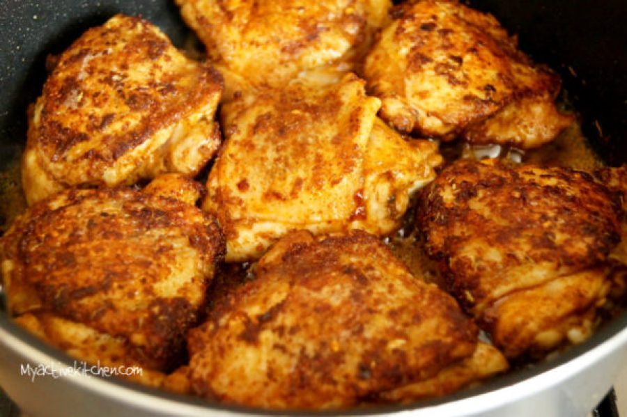 seared spiced chicken in a pan