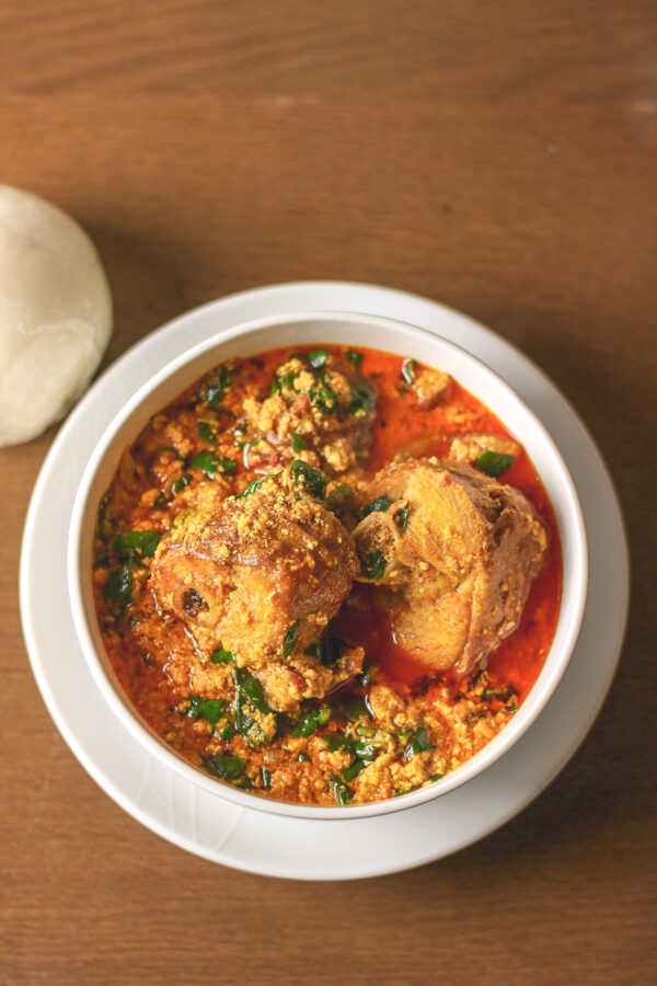 overhead shot egusi soup and pounded yam.
