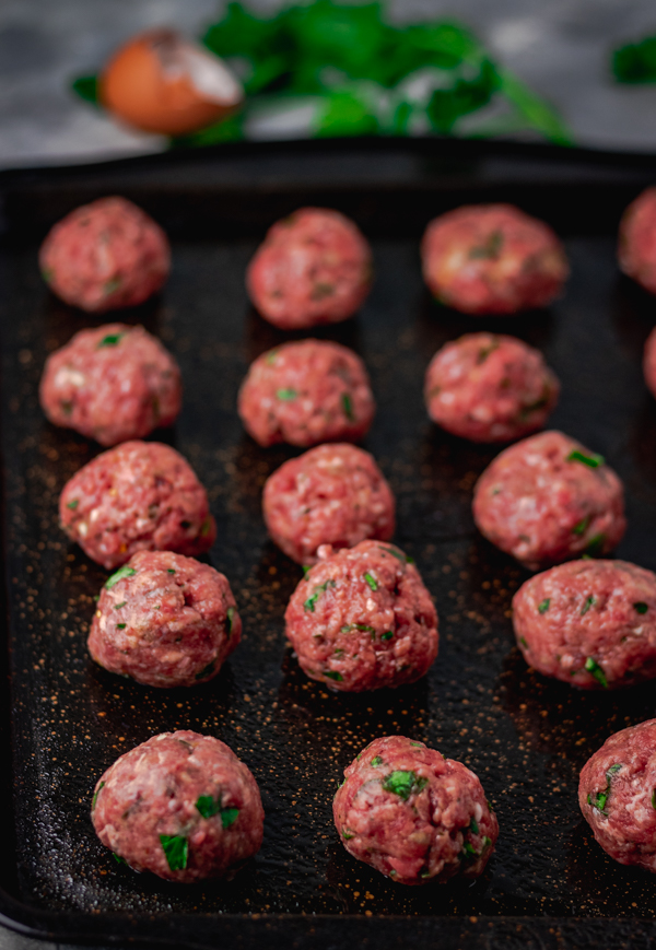 meatballs on a baking tray about to be baked