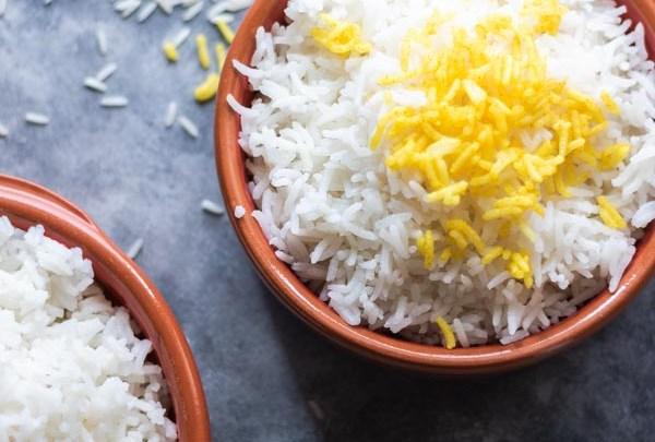 perfect basmati rice seved in a brown ceramic bowl.