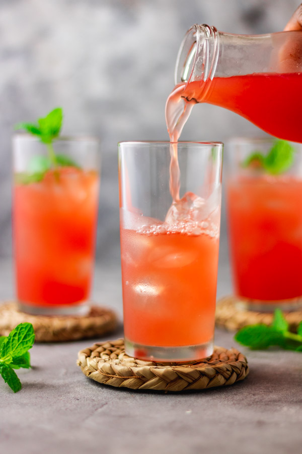 3 glasses filled with watermelon lemonade.
