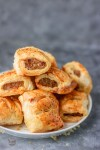 stack of mini sausage rolls in a white plate.