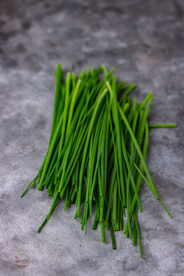 loose chives on a blue hue surface.