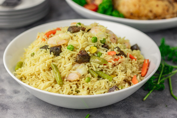 Nigerian fried rice in a white bowl.