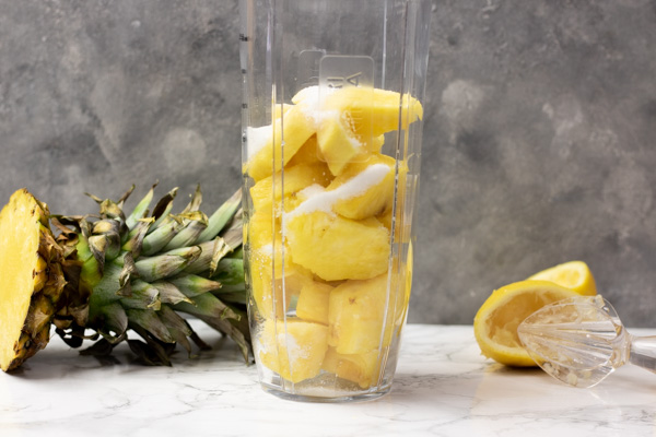 pineapple and sugar in a blender.