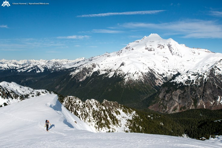 Ascending with Glacier Peak in the background.