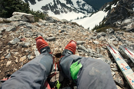 Worn gear and legs above Milk Lake Cirque.
