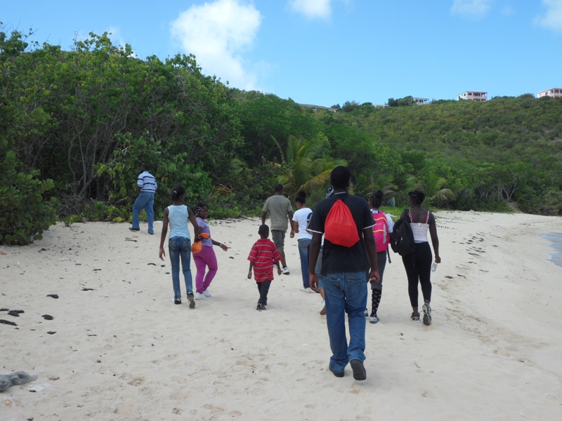 The group walking along Katouche Bay, Anguilla