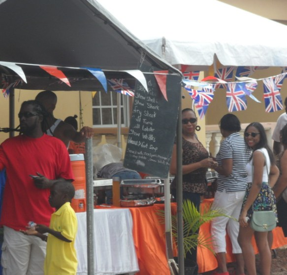 Food tents and event attendees at the South Valley Community Street Fair, Anguilla
