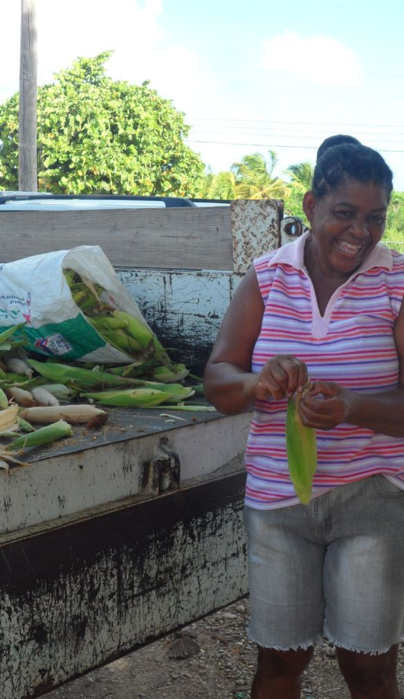 Lovely lady stripping corn in Anguilla