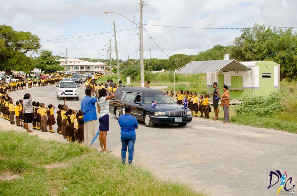 School Children lining the street to pay tribute to Mr. Ronald Webster