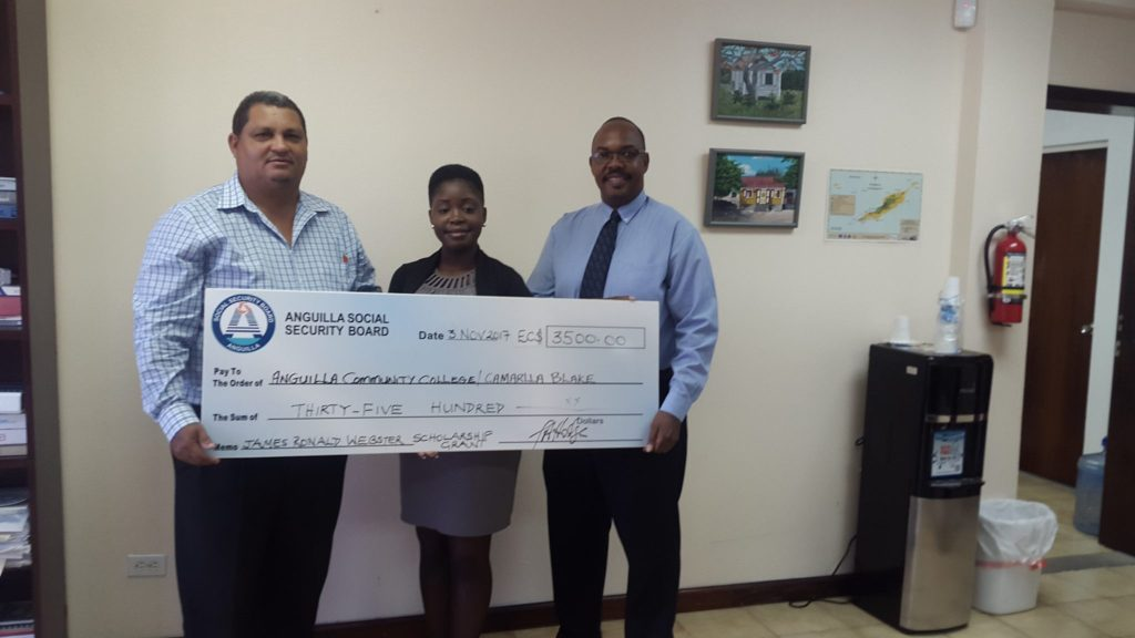 Winner Ms. Camarlla Blake with Director of Social Security, Mr. Timothy Hodge and President of Anguilla Community College, Dr. Karl Dawson