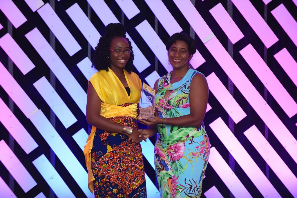 Florence Guishard- Winner of Entrepreneurship Awrd with Minister of Youth Affairs.