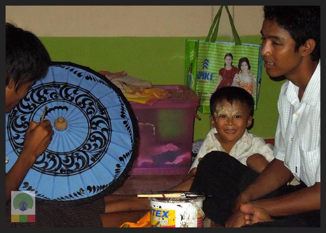 Smiles - Burmese kid at parasol workshop - Pathein - Myanmar (Burma)