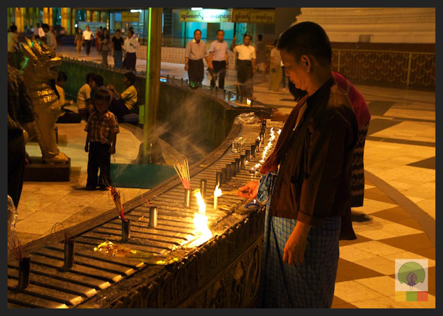 Shwedagon Pagoda by night - Worshipper Lighting Candles - Yangon - Myanmar (Burma) 2