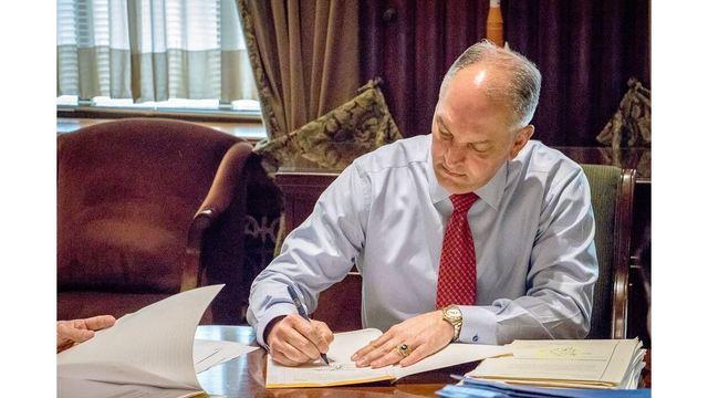 governor edwards signing_1526569323543.jpg.jpg