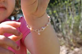 Little girl with bracelts