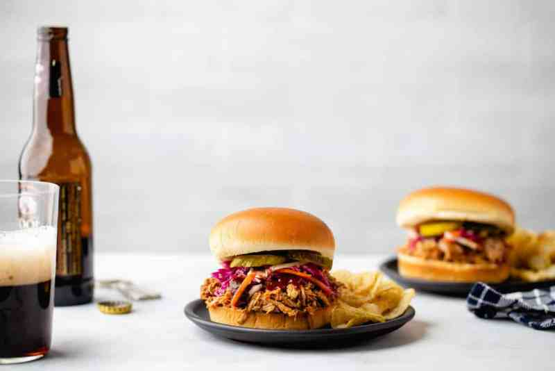 Easy Crockpot Pulled Pork is a game day meal everyone will love. Serve with slaw and pickles for the perfect sandwich.