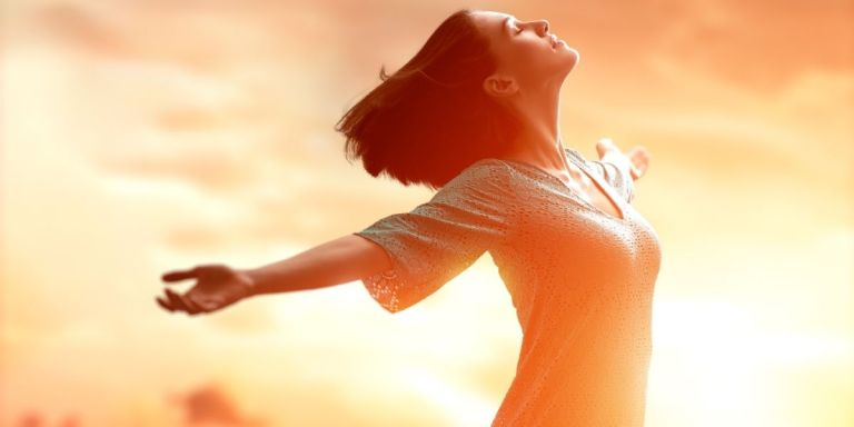 Girl with outstretched arms looking up at the sun.