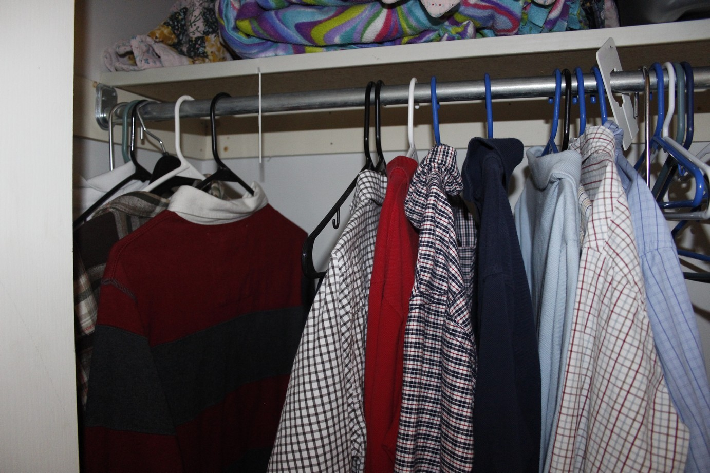 the bottom rack contains the three little boysu0027 clothes separated by boy with one divider and two colors of duct tape william is on the left